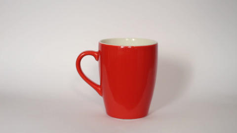 Steaming coffee cup on white background Footage