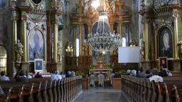Church service in the Catholic church in Warsaw, Poland Live Action