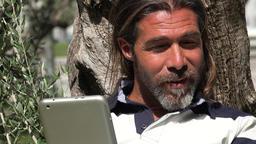 Handsome Man Using Tablet Live Action