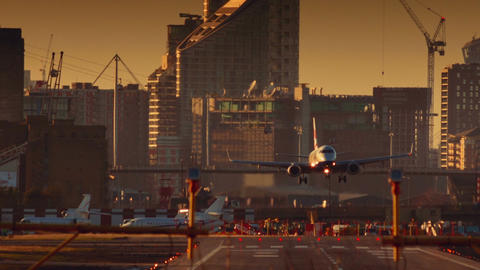 London City Airport - Telephoto shot of a large airliner landing facing the came Footage