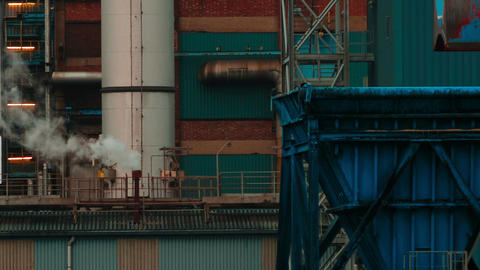 Ultra closeup shot of a plume of smoke coming out of a sugar factory chimney Footage