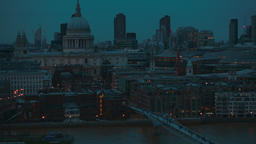 Tilting shot showing the Millennium Bridge and St Pauls Cathedral during the blu Footage