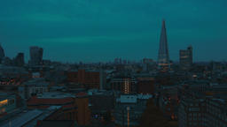 Panning shot of the Shard and south London skyline during the blue hour Footage