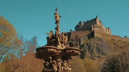 Edinburgh Castle and statues of the Ross Fountain seen from the Princess Street  Footage