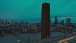 Wide panning shot of the City of London, the Thames and St Pauls Cathedral durin Footage