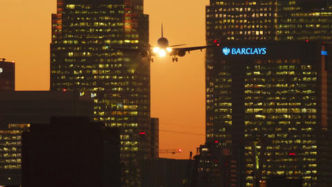London City Airport - Late evening shot showing an airliner landing with importa Footage