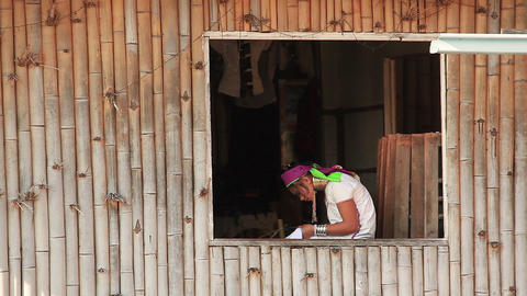 Padaung (Karen) tribe woman weave on traditional device Footage