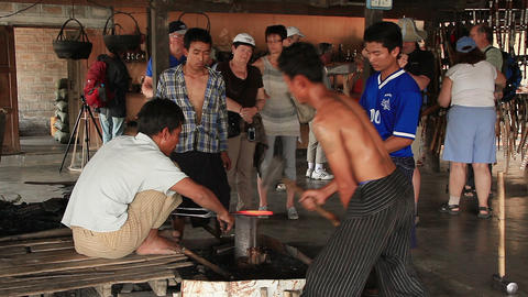 men forged iron in the tourist center of Inle, Myanmar Footage