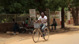 African street scene with bicycle passing Footage