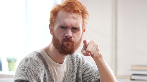 Man with Red Hairs Pointing Toward Camera Footage