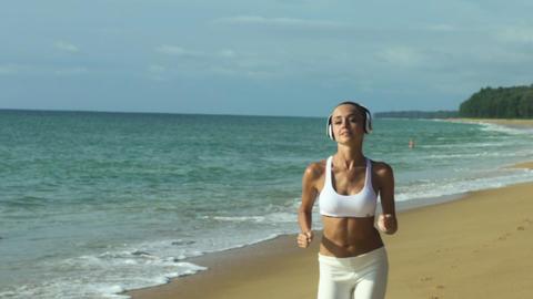 Female Runner Training On Beautiful Beach Footage