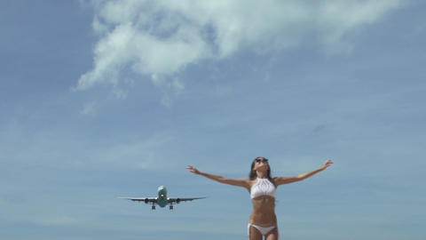 Girl With Raised Hands With Landing Airplane Footage