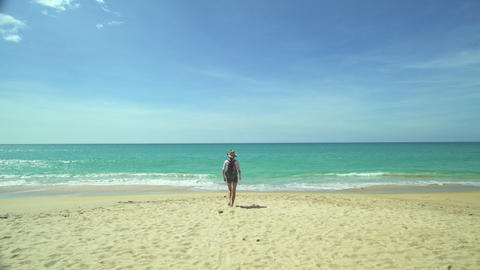Backpacker Girl Walking On The Beach Footage