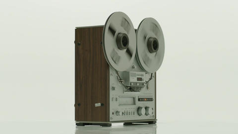 Old reel tape recorder with spinning reels on white background. Reel to reel tap Footage