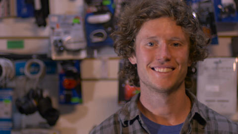 Portrait of a handsome, attractive, millennial man standing in his shop or small Footage