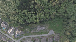 Aerial top down view of a residential area with car driving along Footage
