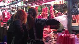 Butcher smoking at Taiwan market Miaoli City Taiwan Footage