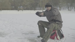 A man catches fish in the winter Footage