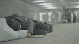 Beggar homeless person sleeps lying on the floor of the underpass Footage