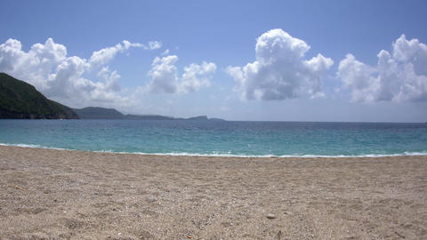 Panorama in a bay with clear blue water and a beach with small pebbles 39 Live Action