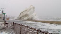 Blizzard waves slam against seawall Footage