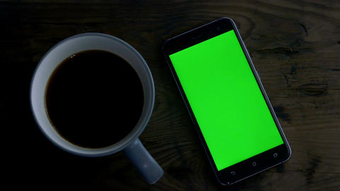 coffee green screen phone distressed wood lights turning off Live Action