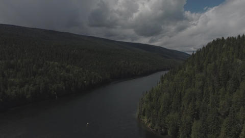Aerial view of a river and a dock on a cloudy day Footage