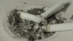 The cigarette extinguish in the ashtray Stock Video Footage