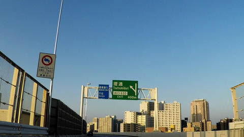 A highway in Tokyo on a sunny day and a building that can be seen there Footage
