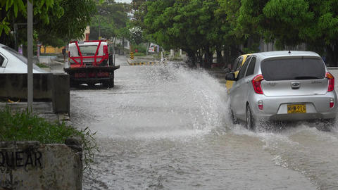 Tow Truck And Cars On Flooded Street Footage