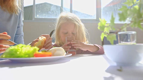 Little Blond Girl doesn't want to eat from Bowl Cries at Table Footage