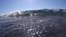 Wide waves rolling towards the camera, low angle, slow motion Footage