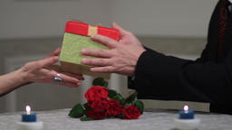 Senior male hands giving gift box to woman Footage