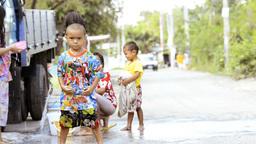 Children Enjoying a Songkran Water Fight in Thailand Stock Video Footage