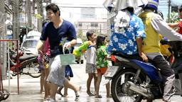 Children Splashing People on a Motorbike During Songkran Festival Footage