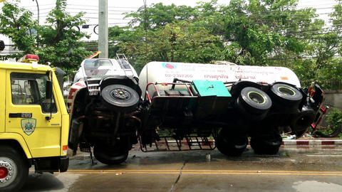 Rolled-over gas truck being put back on its wheels Stock Video Footage