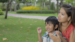Asian Mother and Son Spending Time Together in a Park -... Stock Video Footage