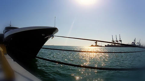 Yacht stem and glittering sun on the water Footage