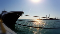 Yacht stem and glittering sun on the water Stock Video Footage