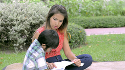 Asian Mother Teaching Her Son To Read - Dolly Shot Stock Video Footage