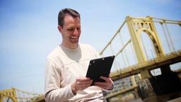 Man Uses Tablet PC Stock Video Footage