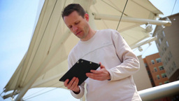 Man Uses Tablet PC Outside Footage