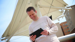 Man Uses Tablet PC Outside Stock Video Footage