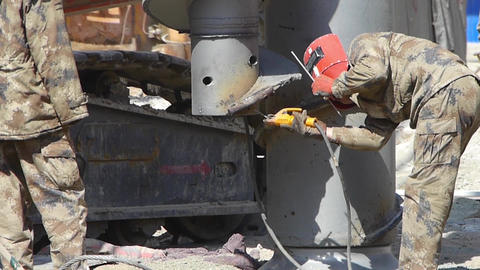 workman welding Heavy Machinery in Construction site Footage