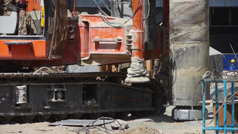 workman command heavy drill machinery moving in construction site Footage