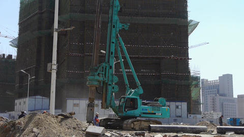 heavy drill machinery moving in construction site Stock Video Footage