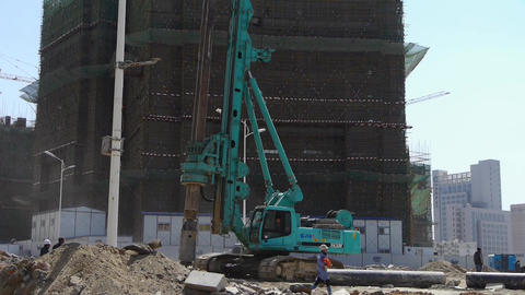 heavy drill machinery moving in construction site Footage