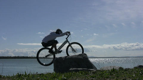 Trials Mountain Bike Jumping On Rocks 5 Stock Video Footage