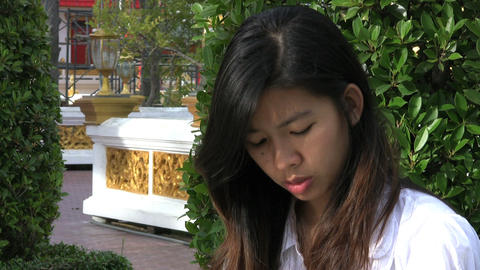 Thai Girl Answering Cell Phone Stock Video Footage