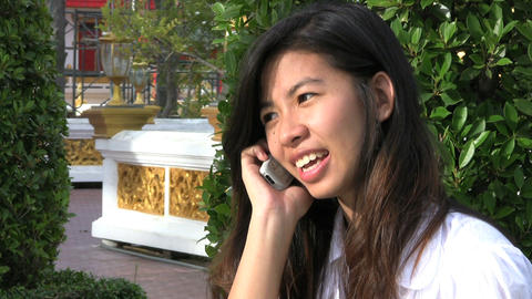 Thai Girl Answering Cell Phone stock footage